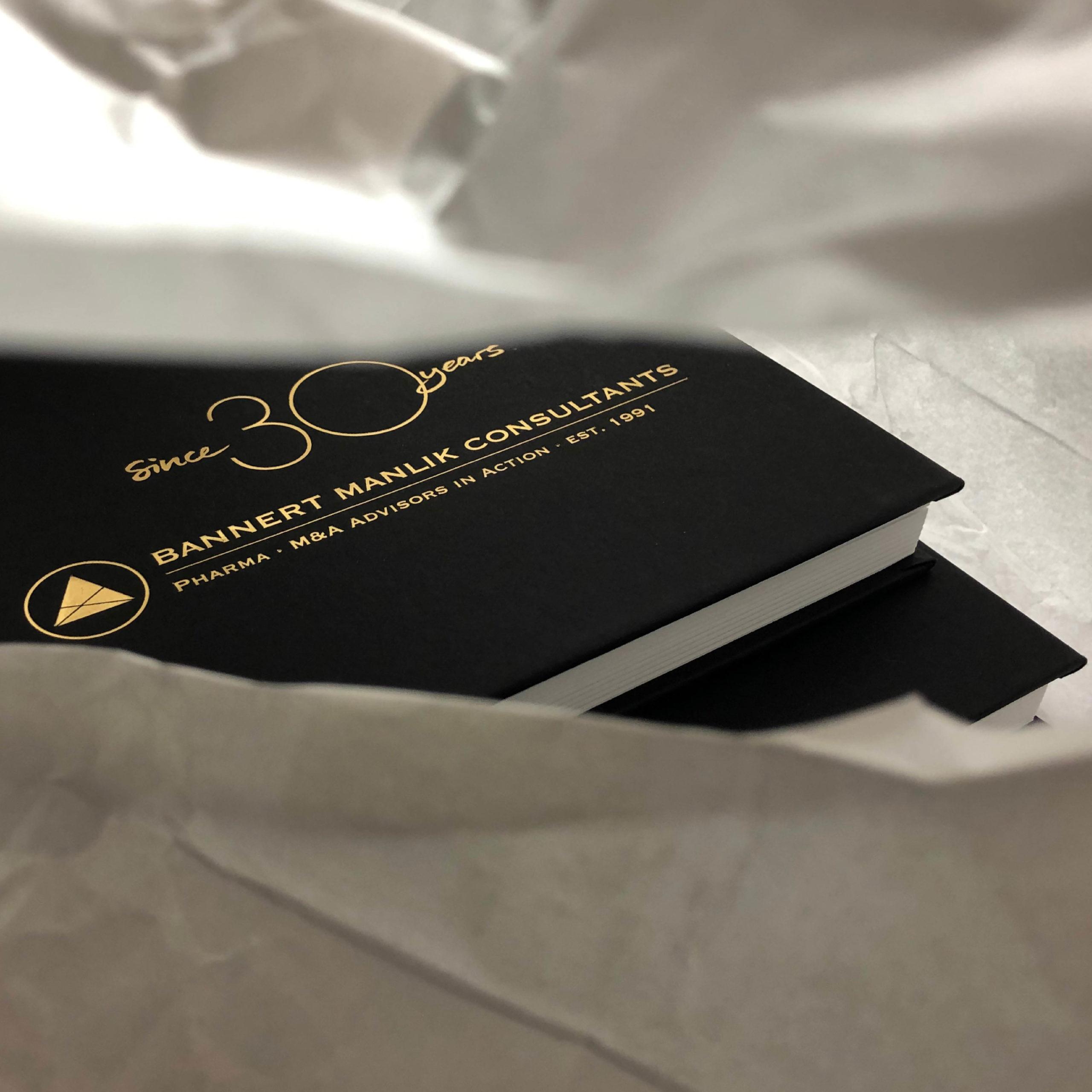 Design eines Notizbuches für Manilik Pharma Consultants